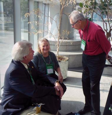 Between business sessions of the World Council of Churches Assembly, the Rev. Stephen Sidorak Jr. (left) confers with Bishop Mary Ann Swenson and the Rev. Bruce Robbins. Photo by Donald Messer.