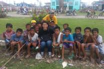 Children from Dagami, Leyte, gather around United Methodist Communications team members April Mercado (front, center) and Ernani Celzo (back). These children are survivors of Typhoon Yolanda. Photo courtesy of April Grace Mercado.