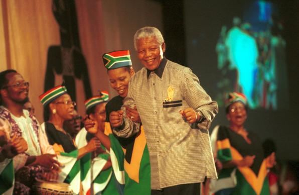 "Mandela is greeted at the 8th assembly of the World Council of Churches in Harare, Zimbabwe, in December 1998. ""Journey to Jubilee"": South African Choir Photo by Chris Black/WCC."