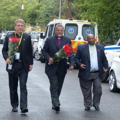 (From left) The Revs. Olav Fykse Tveit, Ivan Abrahams and Vayani Nyobole approaching the Mandela house for an evening prayer service. Photo by Mark Beach/WCC