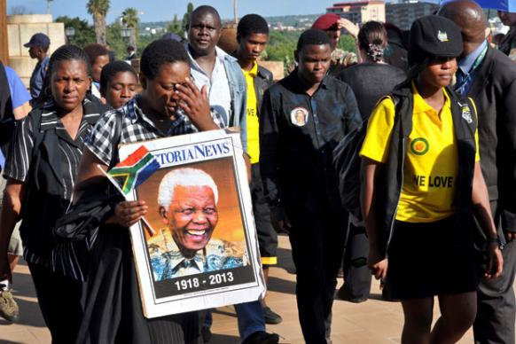 Mourners in tears after viewing the body of the late President Nelson Mandela at the newly renamed Nelson Mandela Amphitheatre at the Union Buildings in Pretoria. Creative Commons photo/GCIS.