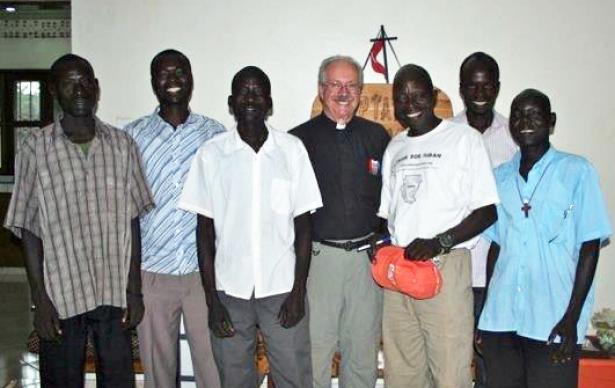 The Rev. Fred Dearing (center) stands with South Sudanese staff members of Grace Home for Children