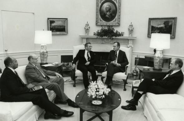 "Four United Methodist bishops ""assure President George H.W. Bush of the prayers of the United Methodist people"" in the Oval Office on Aug. 7, 1989. Pictured from left. Bishops Melvin G. Talbert, Leroy C. Hodapp, Jack M. Tuell (next to the President) and Joseph H. Yeakel. The visit commemorated the 200th anniversary of the visit by Methodist Bishops Francis Asbury and Thomas Coke to President George Washington. Photo by Michael Sargent/The White House."