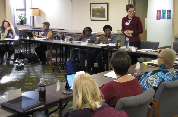 Bishop Sally Dyck of the Northern Illinois Conferenct (standing), host of one of two Ministry with the Poor roundtables, welcomes participants. She is one of several United Methodist leaders who are re-examining how the church ministers with the poor. A UMNS photo by Anne Marie Gerhardt.