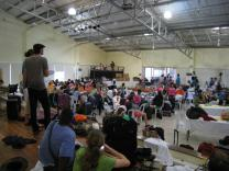 Participants gather as they shelter in place to wait out Typhoon Rammasun, locally known as Glenda.