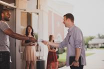 Encourage friendly, out-going persons with the gift of hospitality to serve as greeters and ushers. Image by Pearl, Lightstock.com.