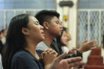 Young people worship at First United Methodist Church in Baguio City, Philippines. The church has a worship service on Sunday afternoons that caters to the young and young at heart, said Dr. Neil Peralta, chairperson for the worship committee. Photo courtesy Baguio City First United Methodist Church Communications Committee.