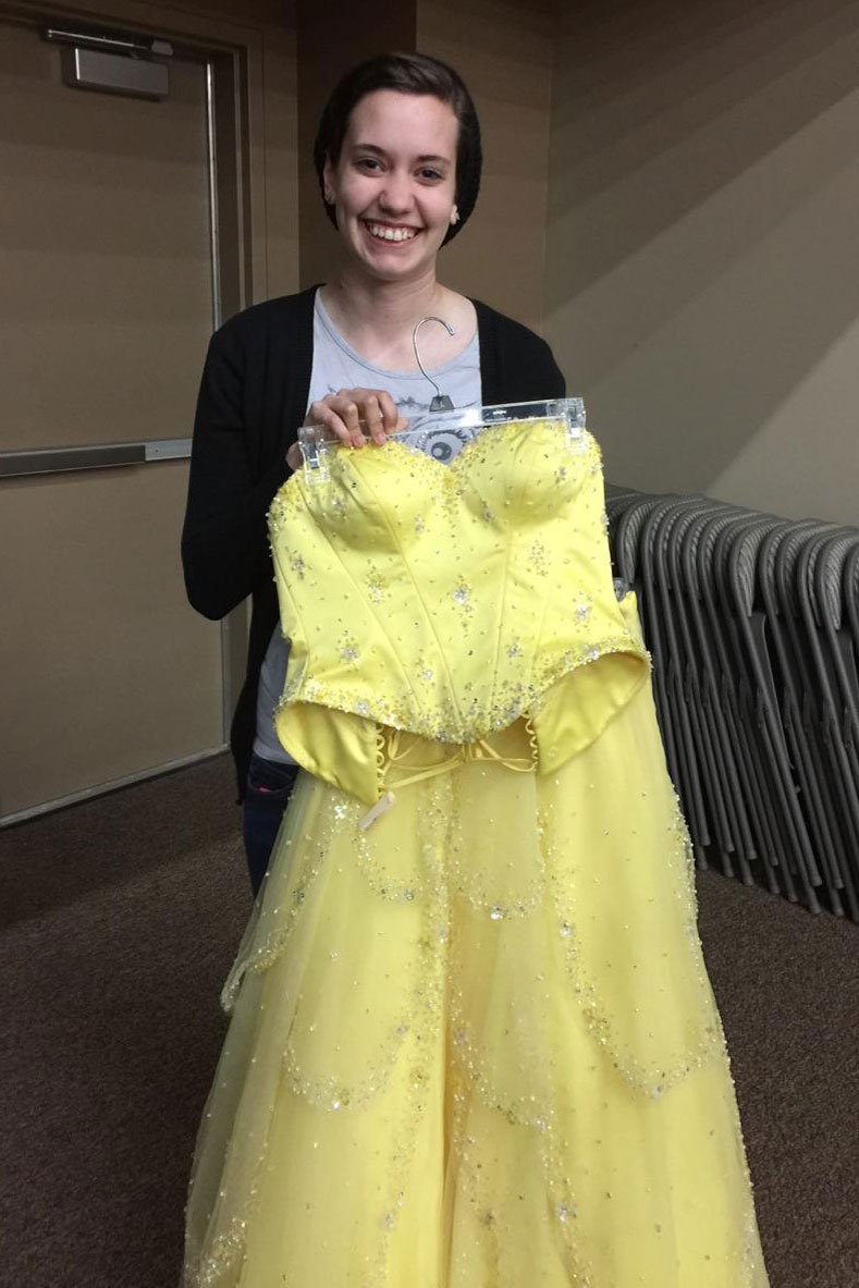 Jordan Paul poses with her yellow prom dress.