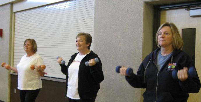 Kathy Osborn, Carol Crall, and Cindy Fish participate in Seniors Exercising Together at Ankeny First United Methodist Church. Photo courtesy of Traci Schermerhorn.