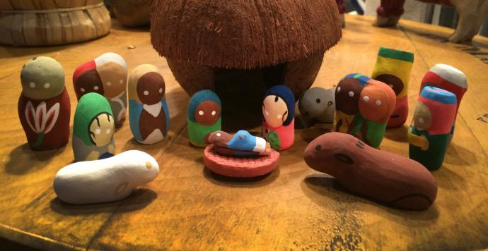 A Nativity set featuring a coconut stable or shelter and figures hand-made from clay, purchased during JoAnn Hall's first mission trip to Haiti. Photo by JoAnn Hall.
