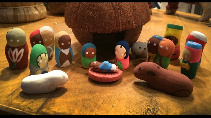 A Nativity set featuring a coconut stable or shelter and figures hand-made from clay, purchased during JoAnn Hall's first mission trip to Haiti. Photo by JoAnn Hall