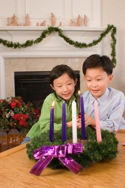 Advent is a time of preparation as children light the second candle of the family Advent wreath. Photo illustration by Ronny Perry, United Methodist Communications