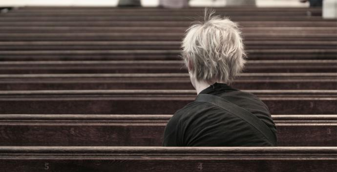 Woman sitting alone in church. Photo by Jamie Carter, courtesy of Flickr.