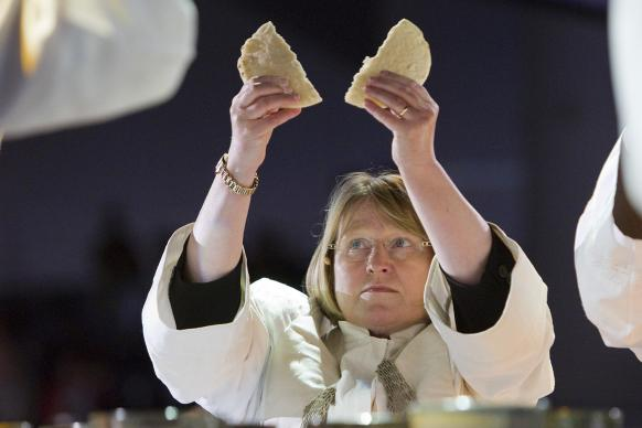 Bishop Rosemarie Wenner of the Germany Episcopal Area, shown here presiding over communion at General Conference 2012 in Tampa, Florida, is working with churches who are in ministry with Syrian refugees in Germany. File photo by Mike DuBose, United Methodist Communications.