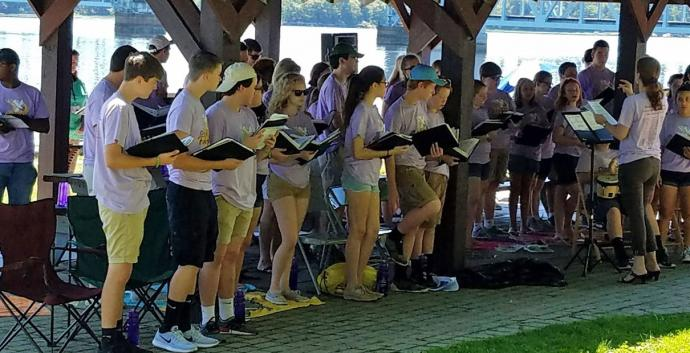 The Charles Wesley Singers, a youth choir from Damascus United Methodist Church in Damascus, Maryrland, sing at a worship service at Waterfront Park in Bath, Maine during their recent tour in New England. Photo courtesy of Damascus United Methodist Church.