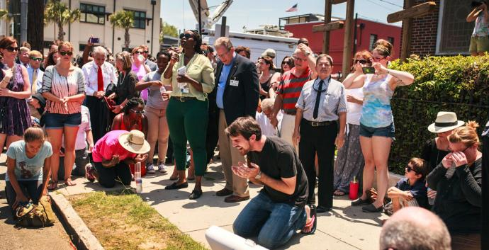 Mike Richards, a street pastor, invites people to kneel to pray and bless Charleston, S.C. Photo by Lekisa Coleman-Smalls, United Methodist News Service.