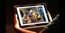 Person views screen on a tablet.  Photo illustration by Kathleen Barry, United Methodist Communications.