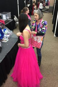 A volunteer works on alterations of a dress.