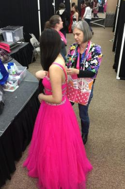 Ginnie Miller, Prom Boutique volunteer, helps with some alterations. Photo courtesy of Prom Boutique.