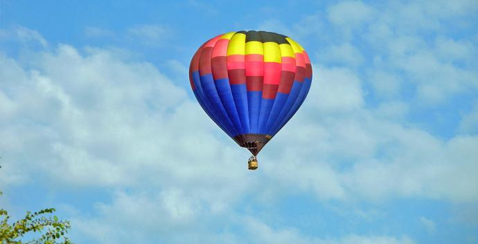 Balloon against a blue sky. Photo by Preston Kemp, courtesy of Flickr.