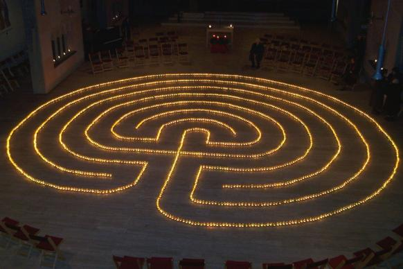 A labyrinth marked by tealight candles. Photo by Urmelbeauftragter, courtesy of Wikimedia Commons.