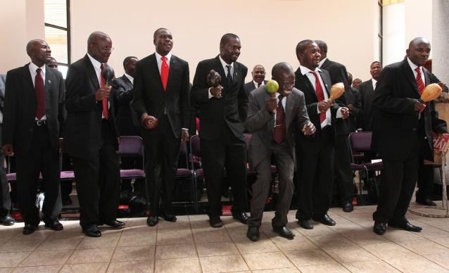 The Men's Association of the United Methodist Church, Harare West District, perform during the Palm Sunday service held in the Kwang Lim Chapel at Africa University. Photo by Kathleen Barry, United Methodist Communications.