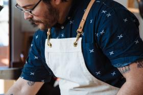 Man at work wearing an apron.