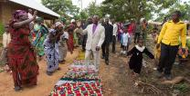 The formal act of welcoming a visitor is a respected custom in African culture. In this photo, Bishop Gabriel Yemba Unda arrives for worship at Nazareth United Methodist Church in Kindu, Democratic Republic of Congo. Cloths are spread on the ground to form a walkway in a sign of traditional welcome. 2015 File photo by Mike DuBose, UMNS