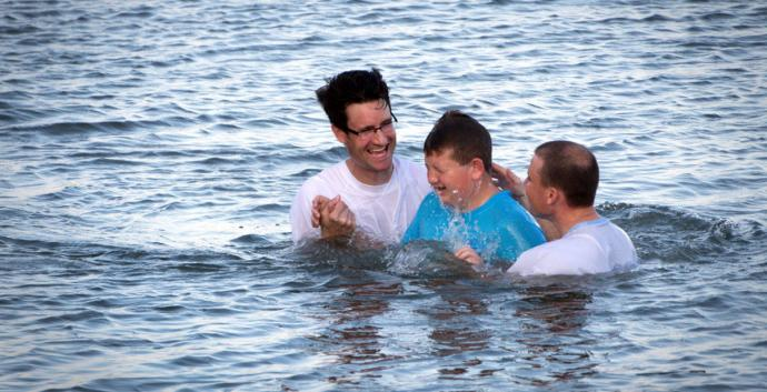 Marshall Greene (center) is baptized during the Annual Inlet Baptism in Murrells Inlet off the Belin Memorial United Methodist Church's seawall. Holding him is (left) Austin Bond, director of youth ministries and (right) Walter Cantwell, associate pastor. Photo by Benjamin Coy