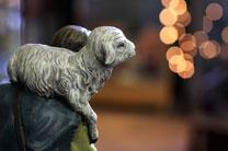 A nativity figure of a shepherd holds a young lamb. Photo by Kathleen Barry, United Methodist Communications.