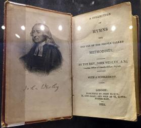 An early hymnal of John Wesley includes a picture of him on the inside front cover.