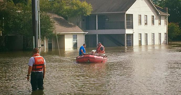 First responders work to rescue those trapped by the Louisiana floodwaters. Photo courtesy of the Baton Rouge Police Department.