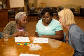 Respite Ministry volunteers play bingo together.
