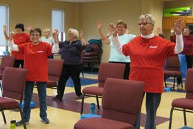 "Seniors workout in the Seniors Exercising Together at Ankeny United Methodist Church in Ankeny, Iowa.  The multi-purpose rooms holds ""both pews and push-ups"" with the mission to help people exercise through community. Photo courtesy of Traci Schermerhorn."