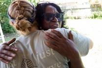 Homeowner Betty Johnson hugs volunteer Jamie Jones who was part of a mission team from Santa Monica, Calif. Photo by Mike DuBose, UMNS.