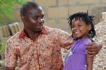 Pedro Chadreque Guambe and his daughter Wendy share a moment together.