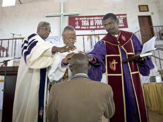 United Methodist clergy are prayed over by their bishop as those pictured in the West Angola Annual Conference in 2006, empowered by the Holy Spirit, and authorized by the church for their life and work. A file photo by Mike DuBose, United Methodist Communications.