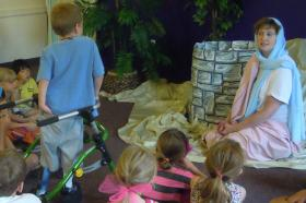Rev. Jean Schwien plays the woman at the well at VBS.