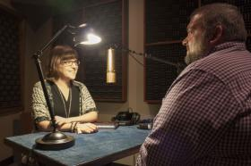 Whitney Simpson being interviewed in the studio.