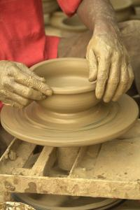 Like clay on a potter's wheel, we continue to be shaped by God's grace.