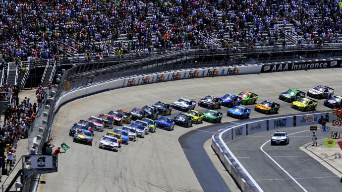 The green flag marking the start of the NASCAR FedEx 400 waves as cars pick up speed prior to crossing the checkered line at Dover International Speedway. Photo by Staff Sgt. Elizabeth Morris, courtesy of the U.S. Air Force.