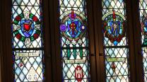 Stained glass windows inside the meditation chapel on an upper floor of the Boston University School of Theology reflect various saints and theologians. Photo by Kathleen Barry, UMNS.