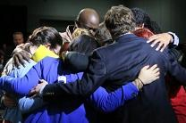 Delegates share a group hug at the 2016 United Methodist General Conference. Photo by Kathleen Barry, United Methodist Communications.