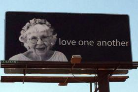 "Shirley Bachelder's ""Love One Another"" billboard."