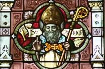 Image of St. Patrick in stained glass window at church in West Melbourne, Australia. Courtesy of Chesterbelloc/Wikimedia Commons.