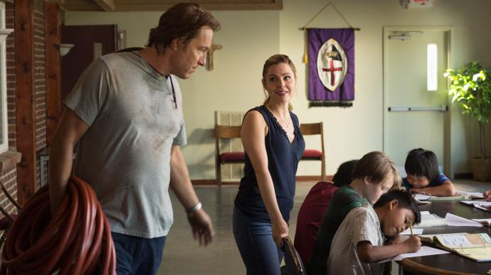 Rev. Michael Spurlock (Corbett, left) and his wife Aimee (Cara Buono) talk about working with the refugee children at All Saints church, in the new movie ALL SAINTS. Photo courtesy of AFFIRM Films and Provident Films.