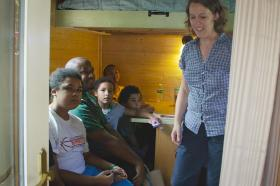 Rev. Rutter teaches about going green and living simply while giving tours of her tiny house.
