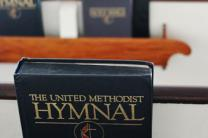 United Methodist Hymnal in a pew-back holder. Photo by Charles Clegg, courtesy of Flickr.