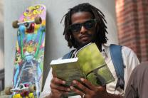Young man reads the Common English Bible. Photo by Kathleen Barry, United Methodist Communications.