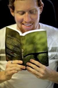 Young man reading Bible.